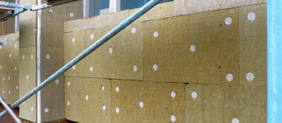 Insulating of facade with mineral wool mats